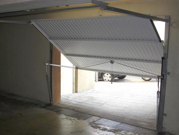 Portes de garage h rmann paris yvelines et les hauts de for Alarme porte de garage basculante